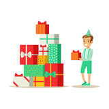 Boy Next To Giant Pile Of Presents , Kids Birthday Party Scene With Cartoon Smiling Character. Part Of Children And Festive Celebration Attributes Series Of Royalty Free Stock Photos