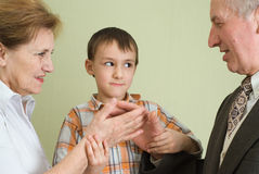 Boy next to grandparents Stock Photos