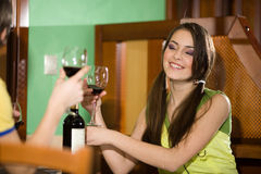 Boy and nice girl drink wine Stock Photos
