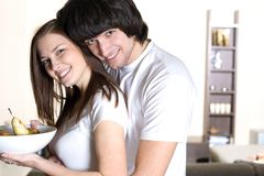 Boy and nice girl with plate Royalty Free Stock Images