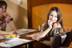 Boy and nice girl at table together Stock Image