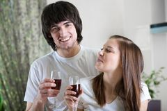 Boy and nice girl with wineglasses Stock Images