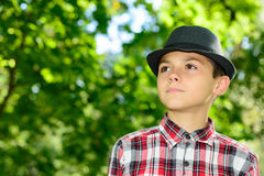 Boy with Nice Hat Plaid Shirt royalty free stock photos