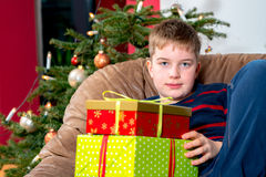 Boy is not so happy with his christmas presents Royalty Free Stock Photo