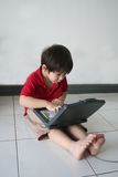 Boy & notebook. Boy using notebook at home royalty free stock photos