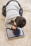 Boy and notebook Royalty Free Stock Photography