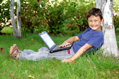 Boy with notebook Royalty Free Stock Photography