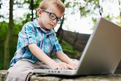 Boy with notebook stock photos