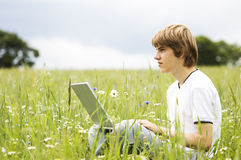 Boy with notebook on the field Stock Images