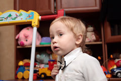 Boy in nursery. The well-dressed boy playing in the nursery Stock Images
