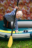 Boy with oar Royalty Free Stock Image