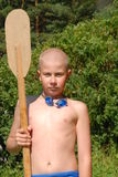 Boy and oar Stock Image