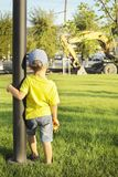 The boy observes the work of the excavator Royalty Free Stock Image