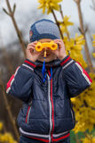 The boy observes in the field-glass Royalty Free Stock Photography