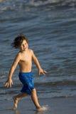 Boy in the ocean Stock Image