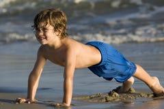 Boy in the ocean Stock Images