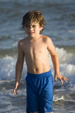 Boy in the ocean Royalty Free Stock Photo