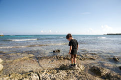Boy by the ocean Stock Image