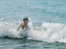 The boy at ocean Stock Photo
