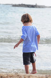 Boy on the ocean coast Royalty Free Stock Images