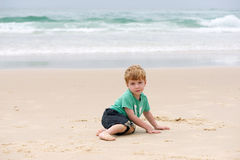 Boy at the ocean Stock Image