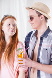 Boy offering a drink to girl Royalty Free Stock Photos
