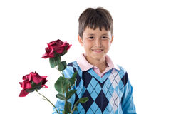 Boy offering flowers Royalty Free Stock Images