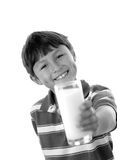 Boy offering us a glass of milk Royalty Free Stock Photo
