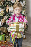 Boy offers Christmas gift Stock Photography