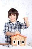Boy offers the keys Stock Photos