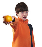 Boy offers  orange Stock Photos