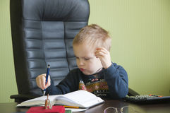 Boy in the office Royalty Free Stock Image