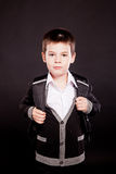 Boy in official dresscode with backpack Stock Photo