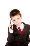 Boy in official dresscode with a cell phone Royalty Free Stock Photo