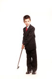 Boy in official dresscode with a golf club Stock Images