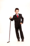 Boy in official dresscode with a golf club Royalty Free Stock Image