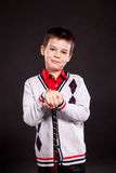 Boy in official dresscode with a putter Royalty Free Stock Photo