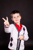 Boy in official dresscode with a putter stock photography