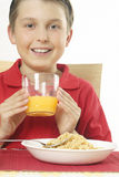 Boy with OJ Stock Photo