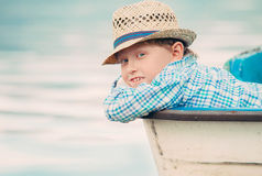 Boy in old boat portrait Royalty Free Stock Photography