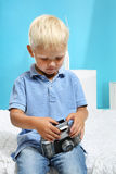 Boy with an old camera. Little boy with an old camera Royalty Free Stock Photo