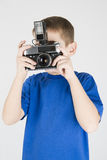 Boy with old camera Stock Photography