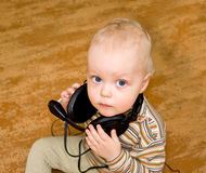 Boy in old ear-phones Stock Image