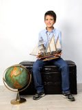 Boy with old globe and ship Stock Photo