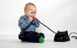 Boy with old phone Royalty Free Stock Photo