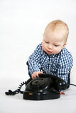 Boy with old phone Stock Image