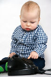 Boy with old phone Stock Photography