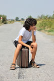A boy with an old suitcase Royalty Free Stock Images