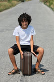 A boy with an old suitcase Royalty Free Stock Photos