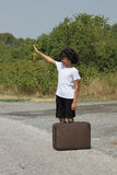 A boy with an old suitcase Royalty Free Stock Image